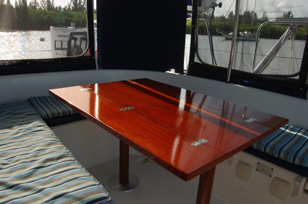 Custom cockpit table with three opening positions. Can be configured for a breakfast nook, happy hour and dinner.