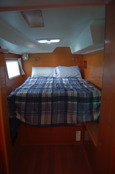 Owner's state room equipped with ample storage spaces. Includes storage beneath bed, hanging locker, two lockers with shelfs, two side lockers. Large hatch above bed, side port, and if we need it, air conditioning keeps the room cool.