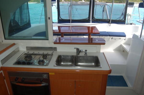 Galley opens to cockpit. Keep room cool and gives the chef an opportunity to socialize while cooking.